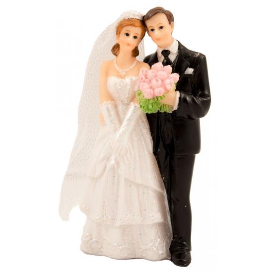 Bruidstaart decoratie bruidspaar met boeket
